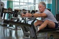 Mature man working out in health club