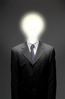 Close-up of a businessman with light bulbs for a head