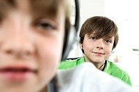 Portrait of two boys listening to music