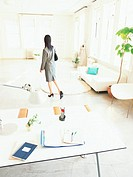 Desk and woman before work