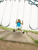 Girl sitting in a swing