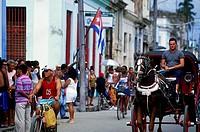 Horse cart in crowded street, Cuba