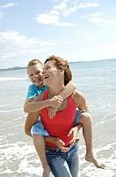 Mother carrying daughter piggyback