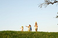 Side profile of family walking in field