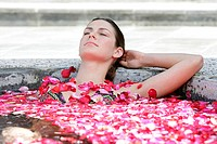 A young woman having aromatherapy bath