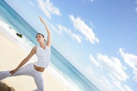 A woman exercising on a beach