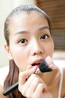 Portrait of woman holding makeup brush