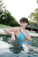 Portrait of a teenage girl in a swimming pool