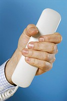 Close-up of a person's hand holding a telephone receiver