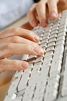 Close-up of a person's hand using a computer keyboard