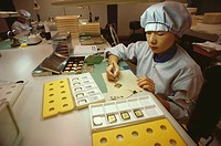Female worker working on a wristwatch dial, Japan