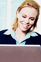 Close-up of a businesswoman using a laptop