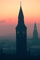 Silhouette of a clock tower at dusk, City Hall, Copenhagen, Denmark