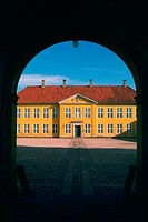 Facade of a palace viewed through an archway, Roskilde Palace, Roskilde, Denmark