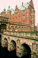 Group of people on the bridge in front of a castle, Frederiksborg Castle, Hillerod, Denmark
