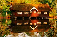 Reflection of a boathouse in water, River Vecht, Netherlands