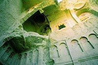Low angle view of the old ruins of a cave church, Zelve Valley, Cappadocia, Turkey