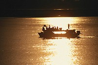 Silhouette of a ferry at sunset in a river, Ayeyarwady river, Myanmar