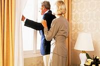 elderly couple at the window