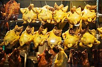 Close-up of chickens hanging in a restaurant