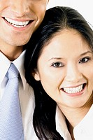Close-up of a businessman and a businesswoman smiling