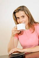 Portrait of a mid adult woman drinking a cup of coffee
