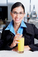 Portrait of a businesswoman with a glass of orange juice
