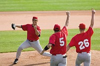 Baseball players celebrating a win