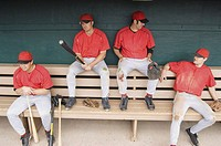 Baseball players in a dugout