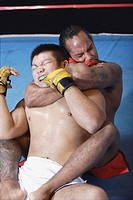 Two fighters grappling