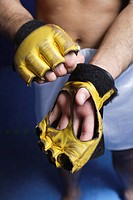 A mixed martial arts fighter's gloves