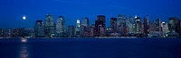 ´Panoramic view of full moon rising over lower Manhattan skyline, NY where World Trade Towers were located´