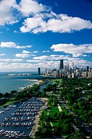 ´This shows Lincoln Park, Diversey Harbor, and Lake Michigan looking south toward the skyline  It has morning light in summertime  There are boats moo...