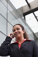 Low angle view of a businesswoman talking on a mobile phone