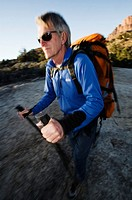 USA, Utah, mature man hiking with walking poles