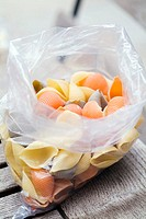 plastic bag of colored pasta shells