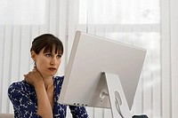 Businesswoman working at desk in office, using computer