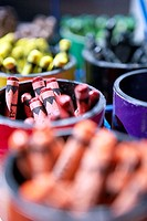 Pots of multi-coloured crayons in rows, close-up still life, differential focus, full frame
