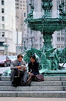 business person Sitting by Fountain