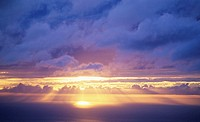 Hawaii, Sunset over ocean, Sunrays bursting through cumulous clouds