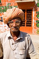 India, Rajasthan, Jodhpur, Portrait of a Hindu man wearing glasses and turban