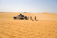 Sudan, Eastern Sahara, Bayuda desert, car getting suck in sand dunes