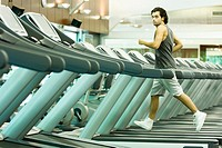 Man running on treadmill in health club