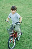 Boy on bike, full length