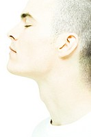 Young man with eyes closed, close-up of face and neck, profile