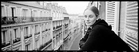 Woman on Paris balcony