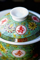 Close-up of a painted porcelain china bowl with lid