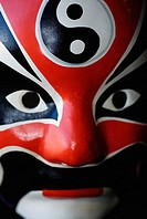Close-up of an asian mask, red, white and black
