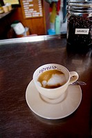 Thailand, Bangkok, an espresso sitting on the counter of a trendy Thai cafe