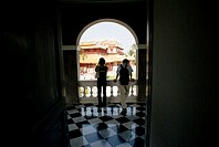 Thailand, Bangkok, Summer Palace at Bang Na, tourists looking out window  NO MODEL RELEASE